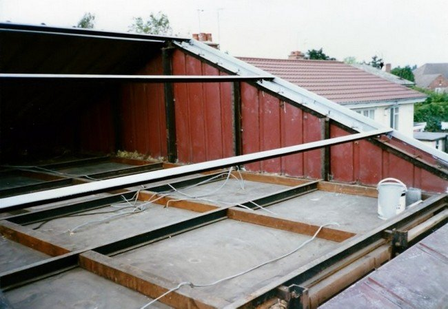 Exposed roof space showing angled steel purlins on bisf house