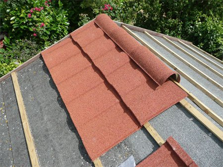 Lightweight steel roof installation on BISF house