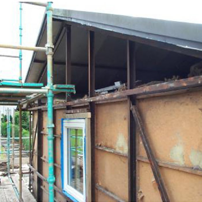 Gable end view of partially stripped BISF House with view to loft space